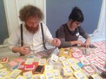 Stephen Fowler and Angie Butler working on stamps by Pineapple Falls and Jane Cradock-Watson. Photo: Helen Allsebrook
